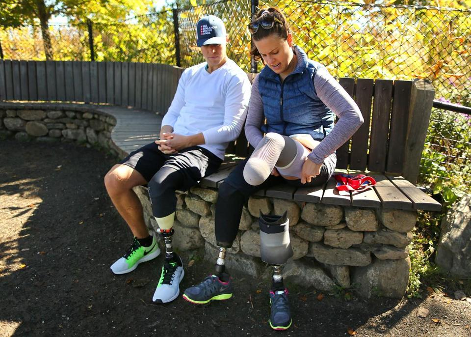 Patrick Downes and Jess Kensky took a break from their walk at Fresh Pond this month as she removed her left prosthetic leg to check for signs of bursitis.